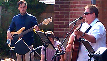 Josh on Bass, Mike Cajon, Dave leading worship